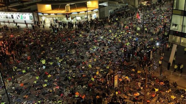 """One thousand cyclists held a """"die-in"""" in front of London's transportation offices on Friday to dramatize the dangers faced by the city's cyclists. Image: ##https://twitter.com/MeredithFrost/status/407286714835955712/photo/1## Meredith Frost/ABC##"""
