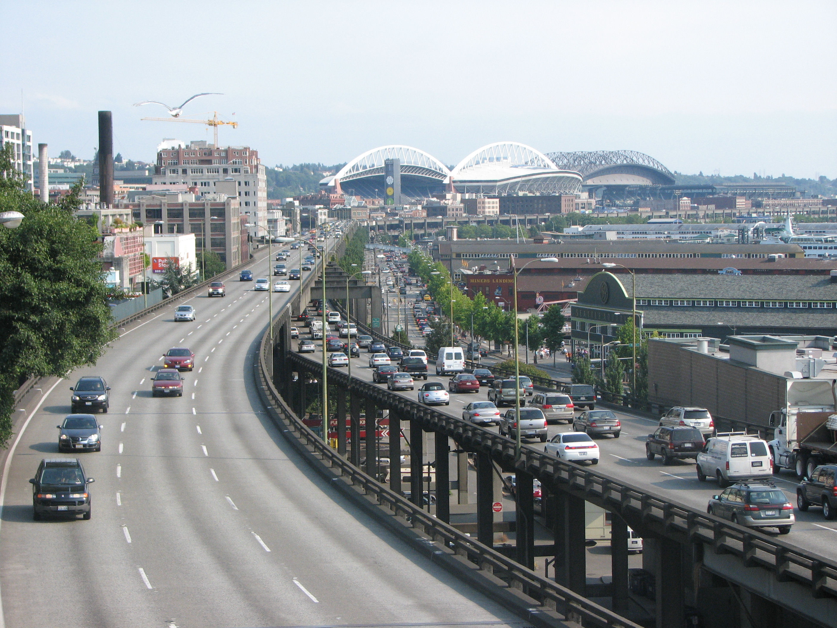 The Alaskan Way Viaduct, damaged decades ago, will be rebuilt as a double-decker highway, even though a transit-heavy alternative would have been at least as effective at reducing congestion. Photo: Rootology/##http://en.wikipedia.org/wiki/Alaskan_Way_Viaduct#mediaviewer/File:The_Alaskan_Way_Viaduct.jpg##Wikimedia##