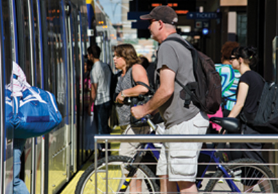 Despite its slow travel time, the Twin Cities' Green Line is surpassing expectations -- in part because the FTA underestimates the university effect. Photo: ##http://www.cts.umn.edu/Publications/catalyst/2014/july/greenline##U of M Center for Transportation Studies##