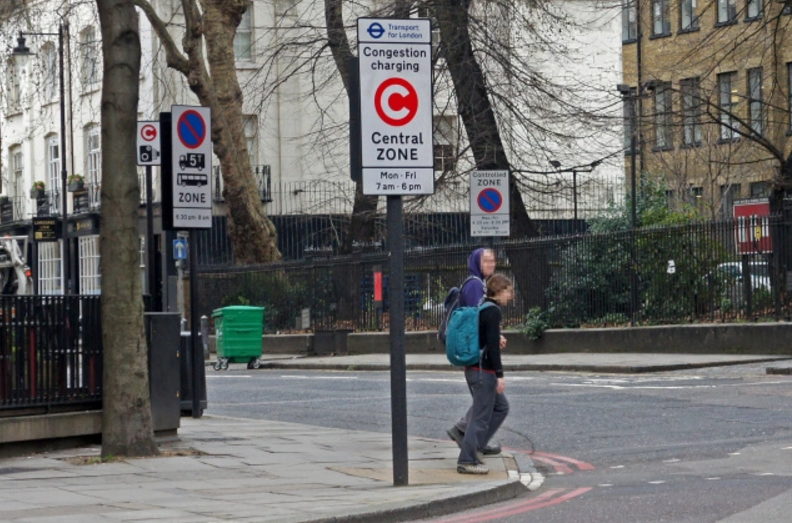 A sign announcing congestion charges in London. Credit: mariordo59, Flickr