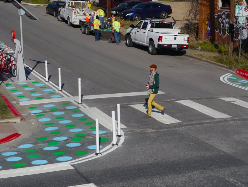 This new painted polka-dot intersection bumpout was design to make a dangerous intersection safer and more comfortable for pedestrians. Photo: Austin Mobility