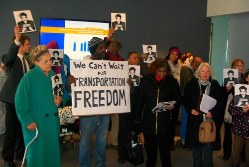 Protesters attended the last Detroit RTA meeting, where the board decided to put off seeking additional funding for transit until 2016. Photo: We Are Mode Shift