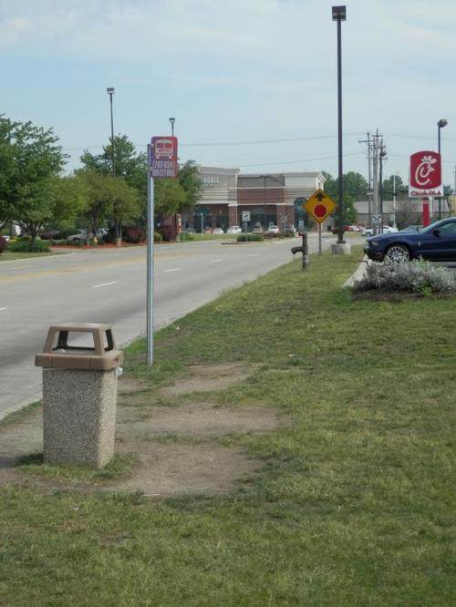 A bus stop on Flight Memorial Drive in Copley Township outside Akron, Ohio. The freedom and mobility that cars offer comes at a high price for those who don't drive. Photo: Jason Segedy