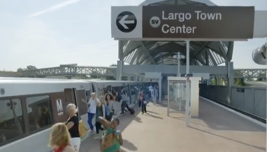 An ad for DC's new Silver Line shows riders dancing into the train. Photo: WMATA