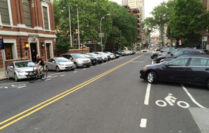 """Worshippers force cyclists out of a bike lane near a basilica in Brooklyn. """"How would Jesus park?"""" asks Invisible Visible Man."""