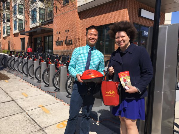 Dr. James Huang, left, shows off the helmets that will be provided as part of D.C.'s new Community Partners Program, offering discounted bike share memberships to low-income people. Photo: Unity Health Care